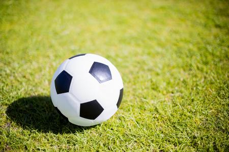 ouside: Football on green field in stadium Stock Photo