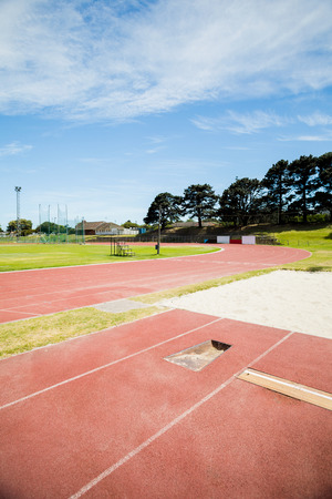 long jump: Long jump sand pit on running track in stadium