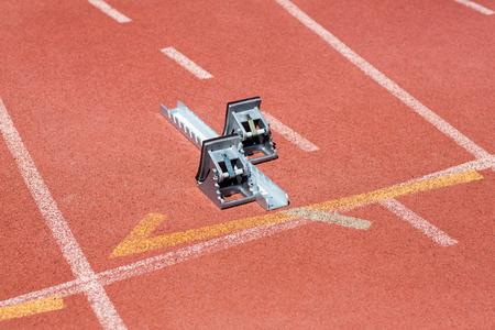 starting block: Starting block on running track on a sunny day
