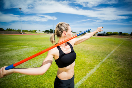 javelin: Female athlete about to throw a javelin in the stadium