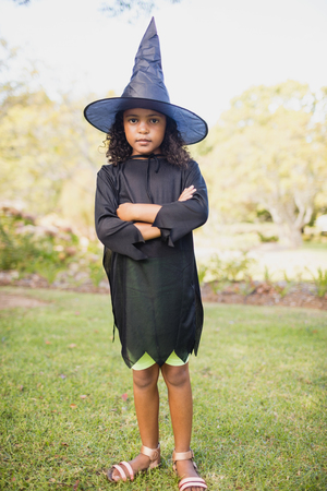 pretending: Cute girl pretending to be a witch in the park Stock Photo