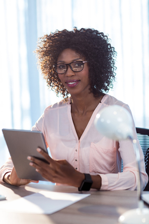 digitized: businesswoman using a tablet in office Stock Photo