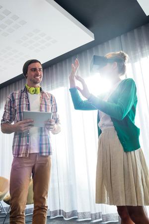 coworker: Coworker using an oculus in office