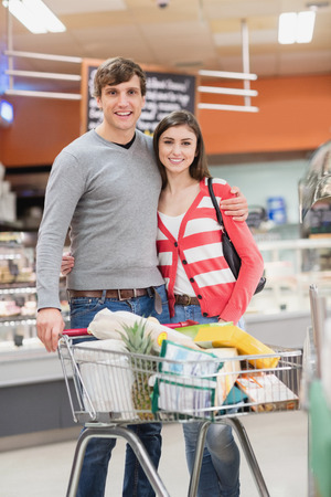 digitized: Portrait of cute couple embracing on a grocery Stock Photo