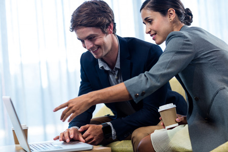 digitized: businessmen using laptop in office Stock Photo