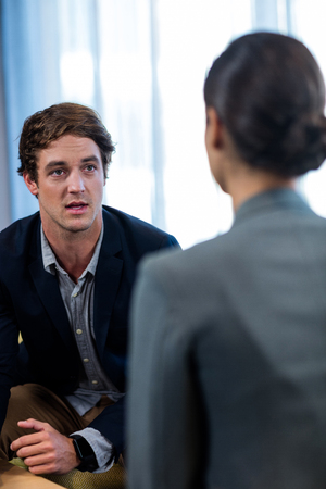 interacting: Businessman interacting with a businesswoman in office Stock Photo