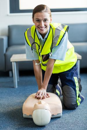 resuscitation: Female paramedic during cardiopulmonary resuscitation training in hospital