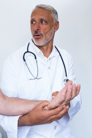 acupressure: Male doctor giving palm acupressure treatment to the patient in the hospital