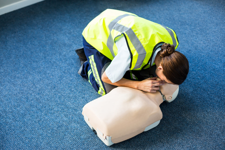 paramedic: Paramedic during mouth-to-mouth resuscitation training in hospital