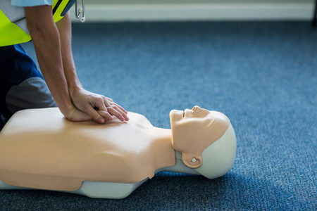 chest compression: Female paramedic during cardiopulmonary resuscitation training in hospital