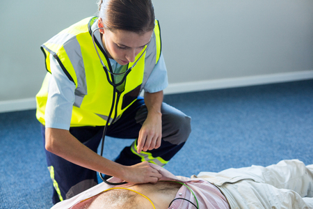 resuscitation: Paramedic examining a patient during cardiopulmonary resuscitation in hospital Stock Photo