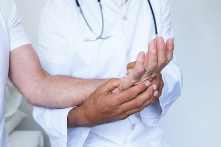 acupressure: Male doctor giving palm acupressure treatment to the patient in hospital