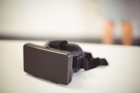 virtual school: Virtual reality headset on table at school Stock Photo