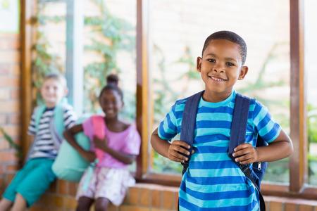 schoolboy: Portrait of happy schoolboy smiling
