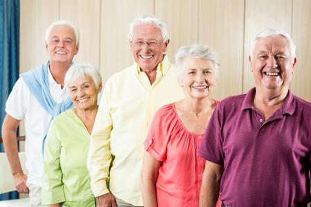 standing together: Seniors standing together in a retirement home Stock Photo
