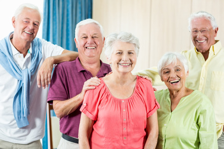 sheltered accommodation: Seniors standing together in a retirement home Stock Photo
