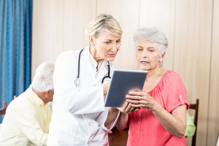 sheltered accommodation: Nurse talking to a senior woman in a retirement home