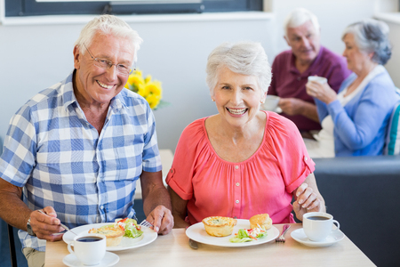 sheltered accommodation: Senior couple having lunch together in a retirement home