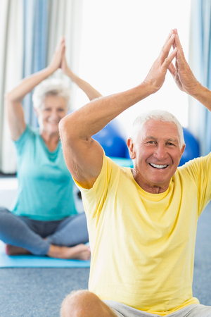 tailor seat: Seniors performing yoga in a studio