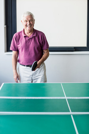 70s tennis: Senior playing ping-pong in a retirement home