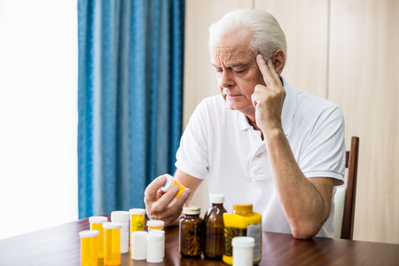 nursing class: Senior sitting in front of medicine in a retirement home Stock Photo