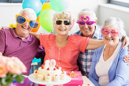 funny glasses: Seniors wearing funny glasses in a retirement home Stock Photo