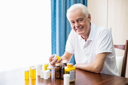 tailor seat: Senior sitting in front of medicine in a retirement home Stock Photo