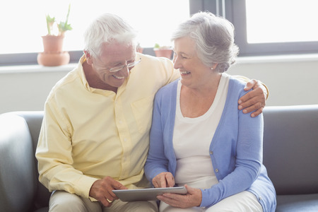 sheltered accommodation: Senior couple using a tablet in a retirement home