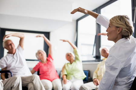 sheltered accommodation: Seniors doing exercised in a retirement home