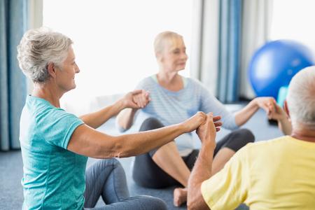 nursing class: Seniors performing yoga during sports class