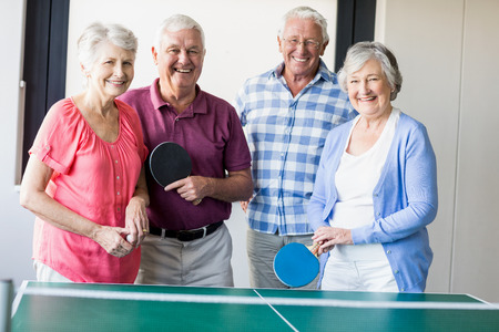 70s tennis: Seniors playing ping-pong in a retirement home
