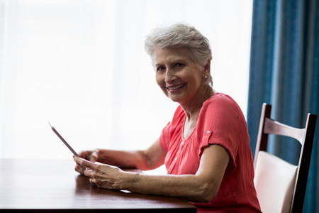 nursing class: Senior woman using a tablet in a retirement home Stock Photo