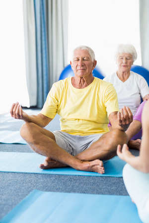 tailor seat: Seniors performing yoga during sports class