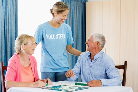 board games: Senior couple playing board games in a retirement home Stock Photo