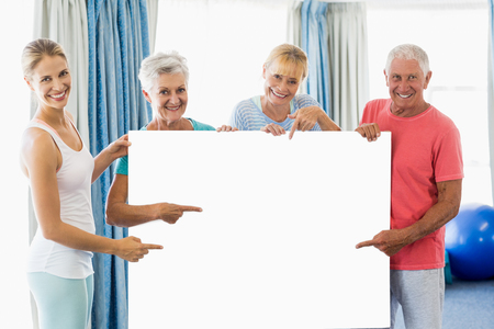 nursing class: Instructor and seniors holding a poster in a studio
