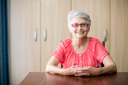sheltered accommodation: Senior woman sitting at a table in a retirement home