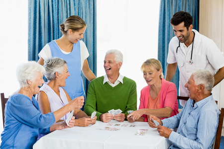 sheltered accommodation: Seniors playing cards in a retirement home