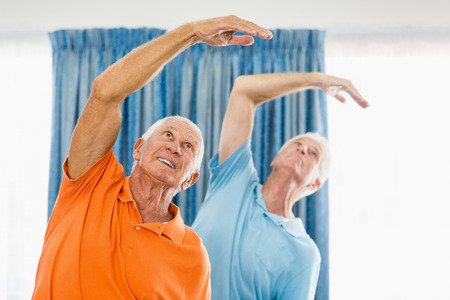 nursing class: Senior men doing exercises at a studio Stock Photo