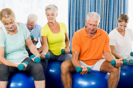 sheltered accommodation: Seniors using exercise ball and weights during sports class