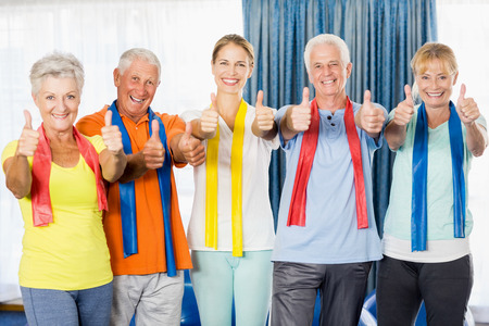 nursing class: Instructor and seniors with thumbs up during sports class