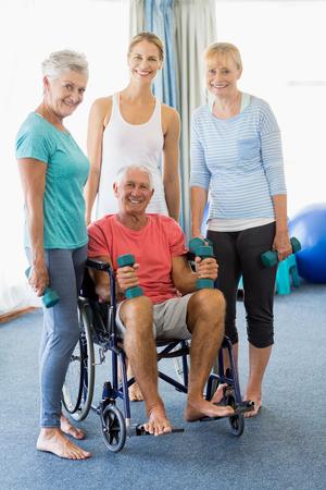 nursing class: Seniors holding weights in a studio Stock Photo