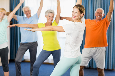 nursing class: Instructor doing exercises with seniors during sports class