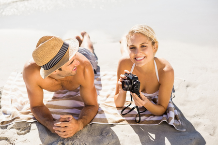 romance strategies: Romantic young couple lying on beach