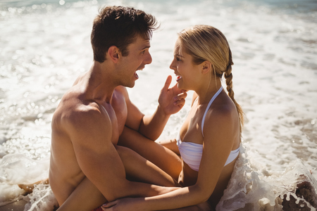 romance strategies: Romantic young couple having fun on beach Stock Photo