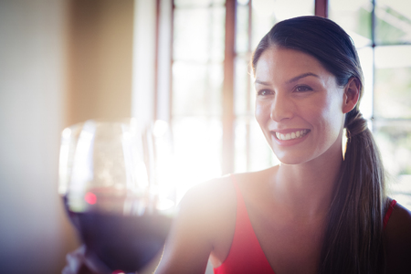 toasting wine: Happy young woman toasting wine glass in a restaurant