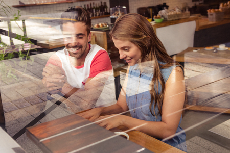 cafeteria: Couple using a laptop in cafeteria Stock Photo