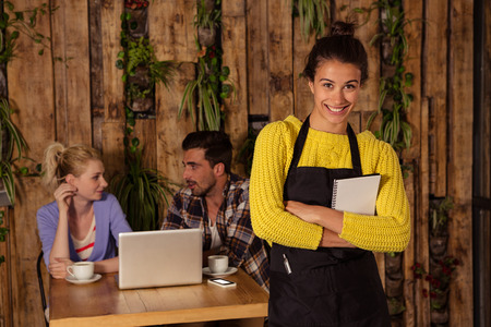 order in: A waitress is taking the order in front of the two friends in a coffee shop Stock Photo