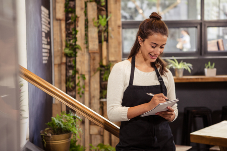 cheese cake: A waitress is taking the order in a coffee shop