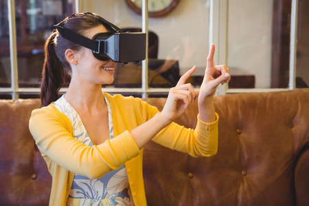 phoning: Business woman using 3D glasses in office Stock Photo