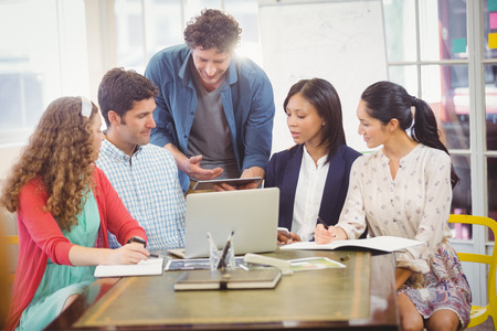 mature adult: Business people working together in office Stock Photo